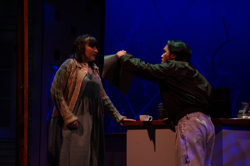 Angry actor showing a folder to a scared actor in the2019 production of The Spitfire Grill
