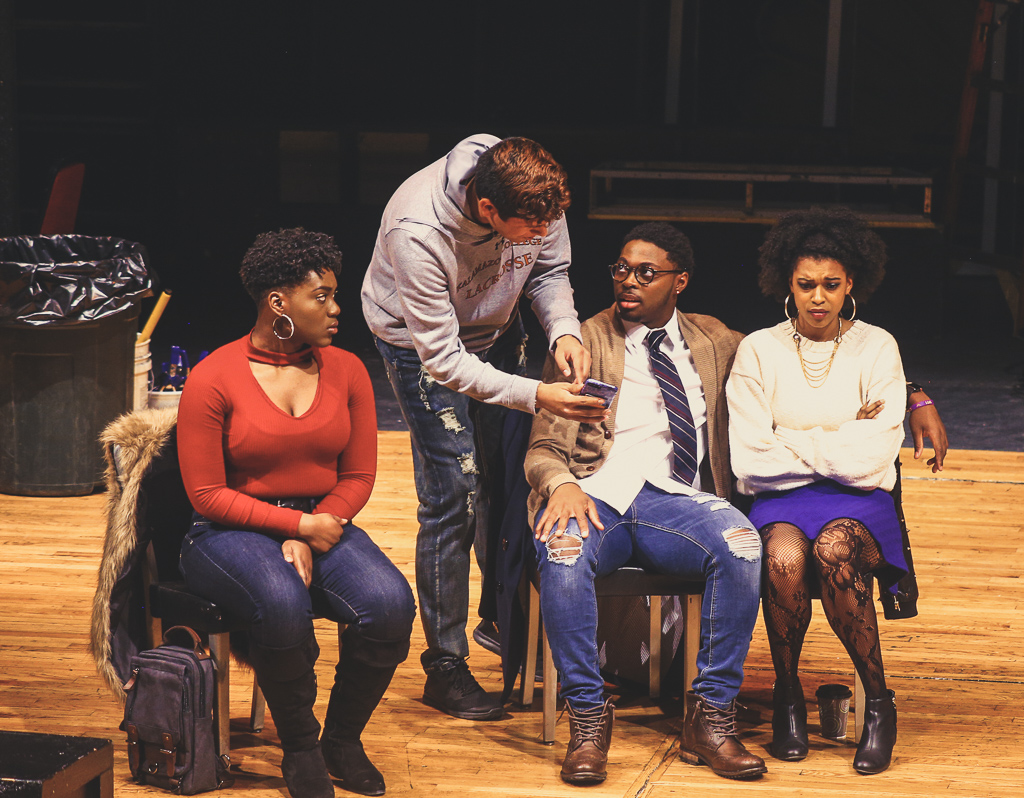 Four actors talking to each other in the play Student Body