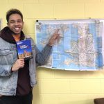 Theatre Student, Trevor, pointing at a map of Northern Ireland.