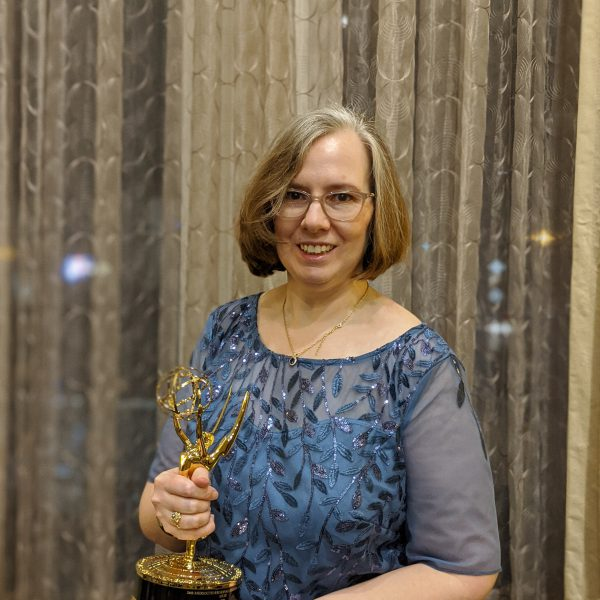Alumni Katy Loebrich with her Emmy Award