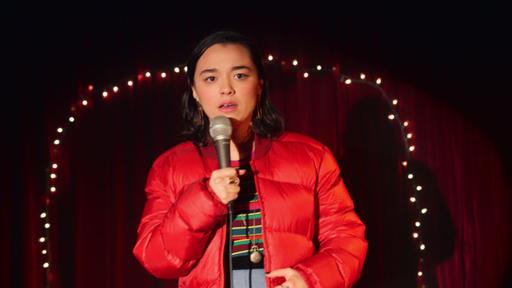 Midori holding a microphone