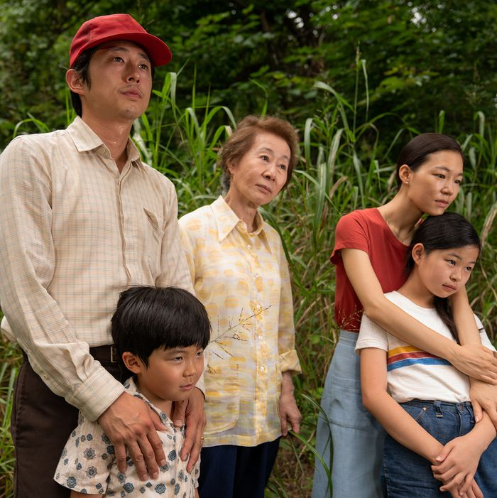A family of Korean Americans standing among tall grass